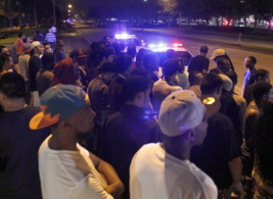 Police containing crowds gathered outside the Florida Mall in Orlando last night.