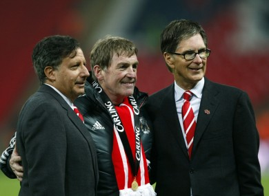 Liverpool's manager Kenny Dalglish, chairman Tom Werner, left, and owner John W Henry.