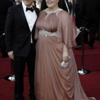Bridesmaids' Melissa McCarthy in custom Marina Rinaldi, who must have been busy pre-Oscars. 