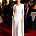 Gwyneth Paltrow chose a structured Tom Ford gown with matching cape.