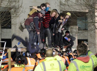 The Occupy camp at St Paul's cathedral being evicted during the night