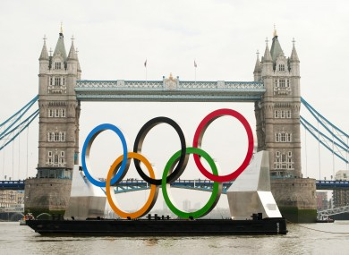 Giant Olympic rings are floated down the river Thames, to mark 150 days to go until the start of the 2012 Olympics