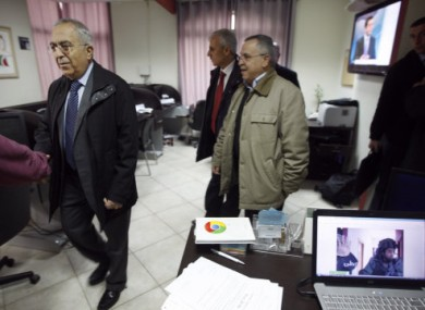 Palestinian Prime Minister Salam Fayyad, left, visits the offices of al-Watan TV after today's raid.