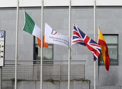 Flags fly half-mast outside Cork University Hospital last year following the air crash.