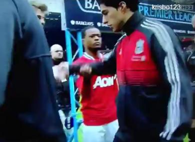 Suarez refuses to shake Evra's hand.