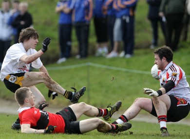 David Quinn of NUI Maynooth (left) scores past UCC's David Farry today.