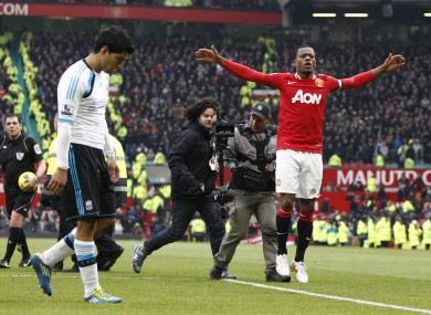 Patrice Evra celebrating under the nose of Luis Suarez.