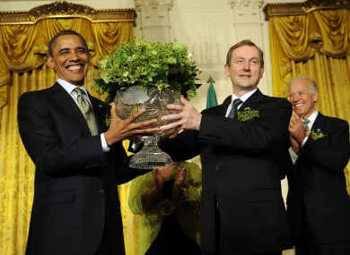 Enda Kenny presents Barack Obama with a bowl of shamrock in the White House yesterday, as vice-president Joe Biden watches.