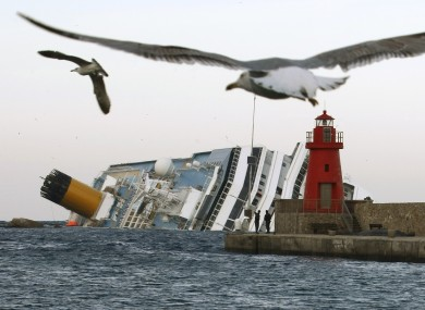 The wreck of the Costa Concordia lies off Giglio
