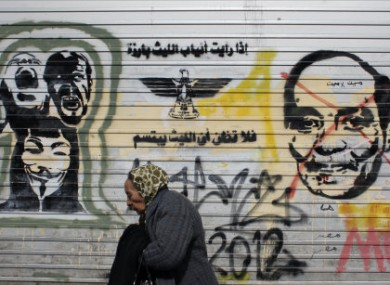 A mural in Cairo depicting military ruler Field Marshal Hussein Tantawi and the words: