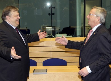 Eurogroup president Jean-Claude Juncker (right) might be happier to see Greek finance minister Evangelos Venizelos in future, after investors agreed to swap their bonds for lesser ones.