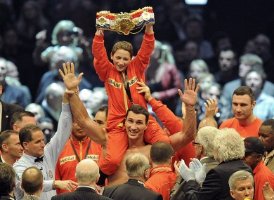 The Klitschkos celebrate with Alex, a young boxing fan from San Francisco.