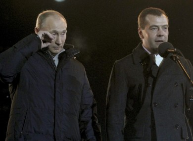 Putin with current president Dmitry Medvedev at a rally in Moscow last night