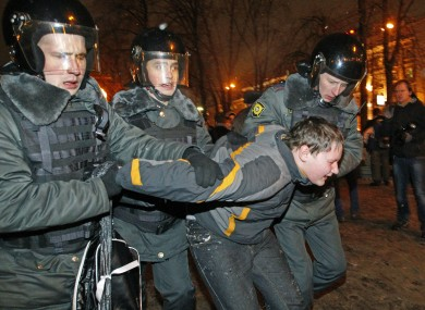 Police detain a protester after a rally in Moscow last night