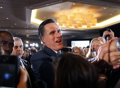 Mitt Romney greets supporters at his election night party in Boston, after taking victory in six of