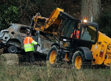 The burnt-out car is removed from the scene yesterday.