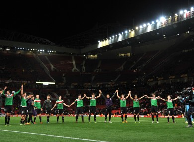 Athletic Bilbao players celebrate victory on the pitch after the match
