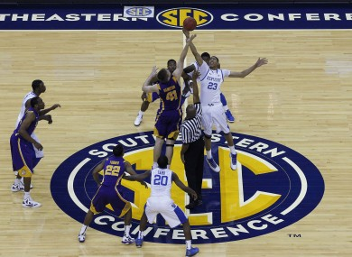 Kentucky forward Anthony Davis (23) controls the opening top against LSU center Justin Hamilton (41).
