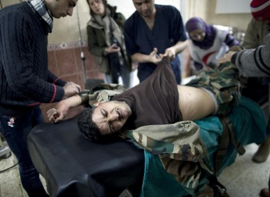A Free Syrian Army fighter is treated by doctors in Idlib, northern Syria