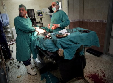 Doctors battle to save a Free Syrian Army fighter in Idlib, northern Syria