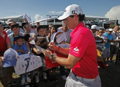 McIlroy signs autographs at the Cadillac Championship last weekend.