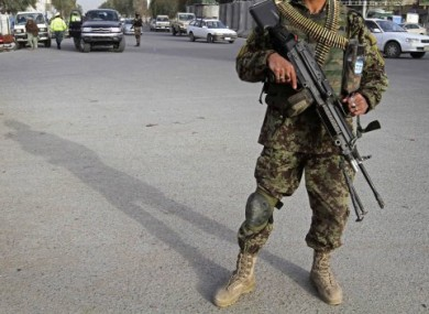 An Afghan soldier guarding a checkpoint in Kandahar province.