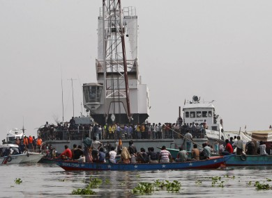 Rescuers search for victims of a ferry accident on the Meghna River in Munshiganj district, about 32 kilometers (20 miles) south of Dhaka, India