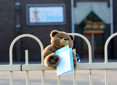 a teddybear at the entrance gate of the primary school 't Stekske in Lommel.