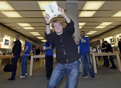Lukas from Germany is the first to get the new iPad at the Apple store in a shopping mall in Oberhausen, western Germany, Friday, March 16, 2012