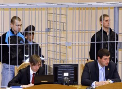 Dmitry Konovalov, left, and Vladislav Kovalyov stand in a defendant's cage during their trial in September 2011.
