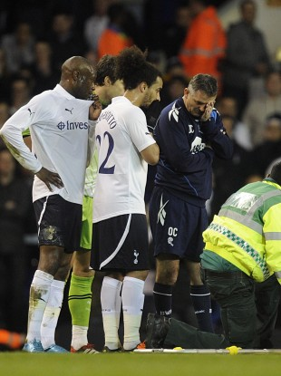 Tottenham players react after Muamba collapses on the pitch.