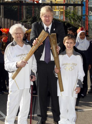 London 2012 Olympic Torchbearers Dinah Gould aged 99 (left) and Dominic John MacGowan aged 11 (right) with London Mayor Boris Johnson