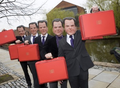 Five people dressed as Chancellor George Osborne mark the UK Budget Day in Manchester.