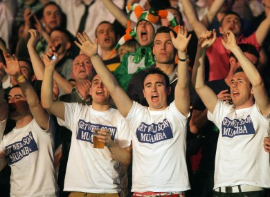 Darts fans show their support for the Bolton midfieler at the O2 Arena, Dublin last night.