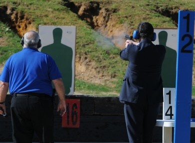 Santorum, right, at the firing range during a campaign stop on Friday morning.
