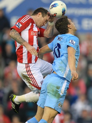 Glenn Whelan and Edin Dzeko challenge for the ball