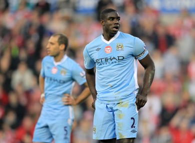 Micah Richards and Paolo Zabaleta look dejected