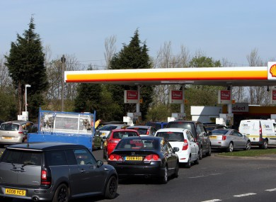 Drivers queue for petrol and diesel at a fuel station in Gateshead in England today