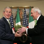 Taoiseach Bertie Ahern seems to have surprise President George W Bush with this bowl of shamrocks in the Roosevelt Room of the White House on St Patrick's Day in 2006. (AP Photo/Charles Dharapak/PA Images)