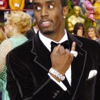 Sean Combs showing off his 'bling' at the Academy Awards in 2005. (AP Photo/Chris Pizzello)