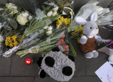 Flowers and tributes are placed outside the Sint Lambertus school in Heverlee, Belgium