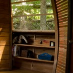 Interior storage space built into the treehouse. (Image via Joel Allen)