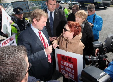 Enda Kenny meets with the Priory Hall residents while at a nearby industrial estate today.