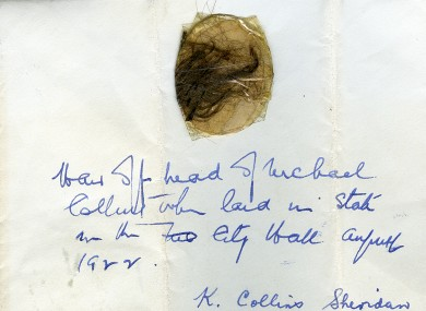 The lock of Michael Collins' hair, attached to a letter in the handwriting of his sister Kitty.