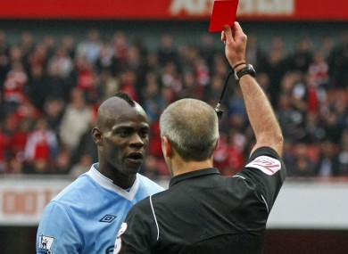 Mario Balotelli sees red after his late challenge on Bacary Sagna earned him a second caution