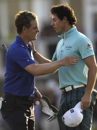 Luke Donald and Rory McIlroy compare notes at the Dubai World Championship in 2011