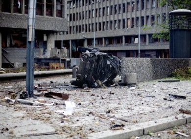 The wreckage of a car at the scene of the Oslo explosion, July 2011.