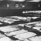 Sleeping accommodation at Plymouth Docks ready for Titanic crew survivors who preferred to go to their homes without delay: dining-tables are visible in the background. (Topham/Topham Picturepoint/PA Images)