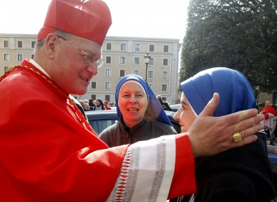 File photo of New York's Cardinal Archbishop of New York, Timothy Dolan, greeting some nuns.