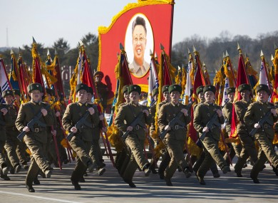 North Korean soldiers march and carry a portrait of the late North Korean leader Kim Jong Il during a military parade at Kumsusan Memorial Palace in Pyongyang.
